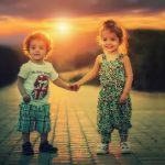 Two young children holding hands who have benefited from child custody mediation.